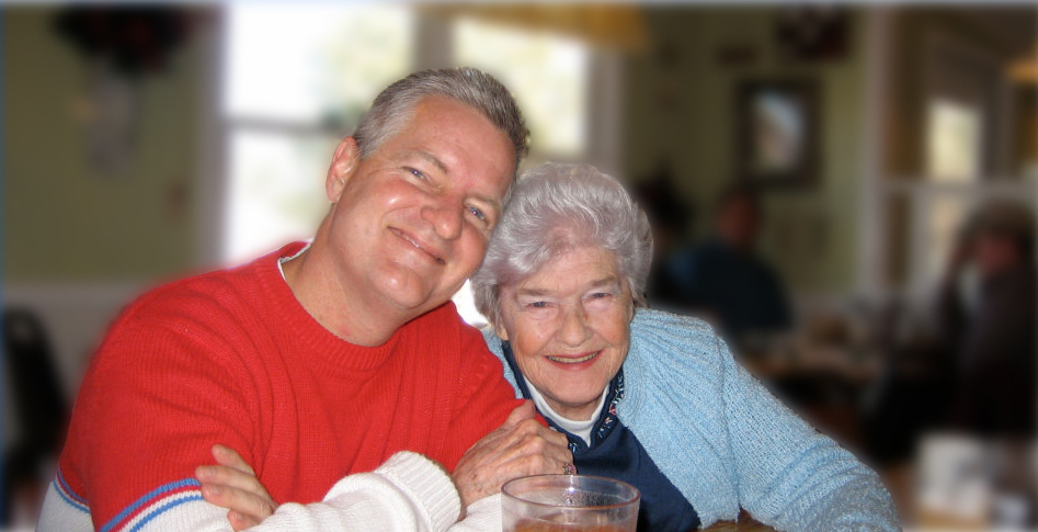 man and senior woman smiling