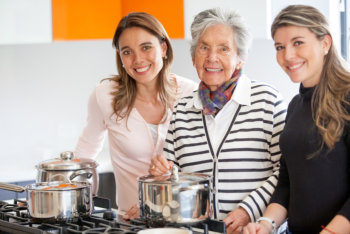 caregivers and elderly woman smiling